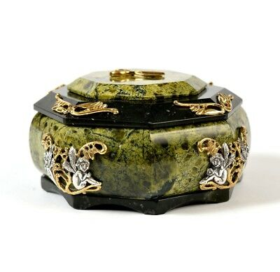 Jewelry box made of coil with silver lining in gilding.