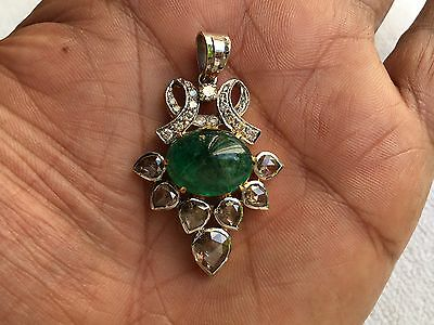 ANTIQUE ANGLO INDIAN CABOUCHON EMERALD AND DIAMOND PENDANT.1910. Over 7 carats.