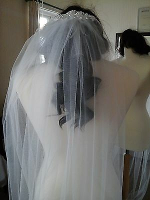 Bridal veil Ivory, chapel length. 97 ins One tier Lace over the comb.