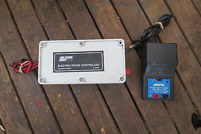 electric fence controller with power supply