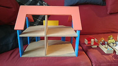 Early years wooden dolls' house
