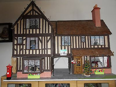large wooden tudor dolls house and furniture +lighting REDUCED