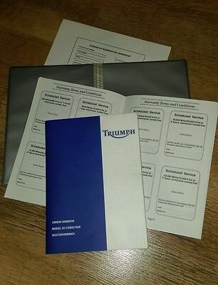 TRIUMPH Owners Handbook Manual and UN-stamped service book, 1999