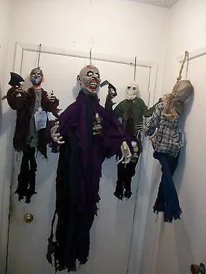 ANIMATED HANGING ZOMBIES. LOT OF 4. NEW. Halloween props. MOVE, SOUNDS, LIGHTS.