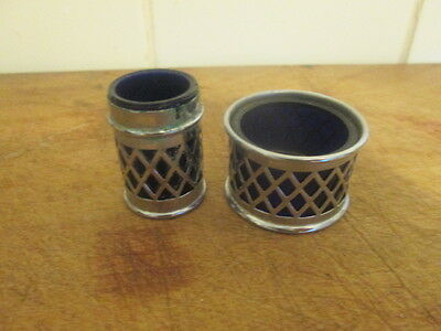 pair of chrome finished holders with cobart blue glass liners