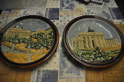 two European wall plates decorated with architectural scenes 30cm diameter