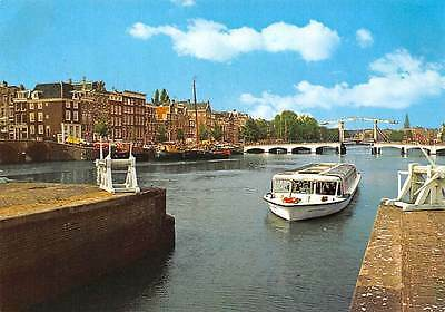 Netherlands Amsterdam The Amstel with Skinny Bridge Boat