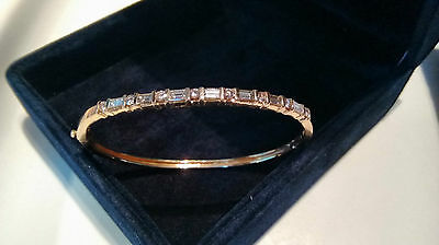 14kt Yellow Gold Baguette and Round Diamond Solitaire Bangle Bracelet