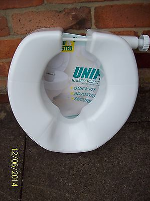 A raised toilet seat, Unifix make. White. Used, very good condition.
