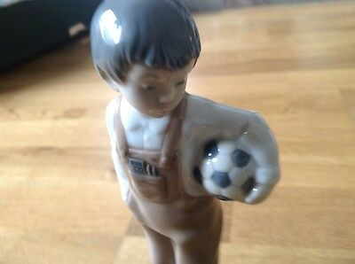 Nao by Lladro Figurine Wanna Play Boy with a Football Under his Arm.