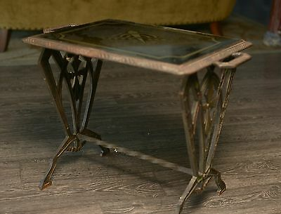 antique cast iron deco table with foiled glass top