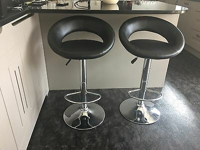 2 Black faux leather and chrome gas lift bar stools.