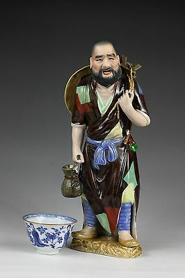 20th Century, A rare 'famille rose' Chinese porcelain fisherman figure.