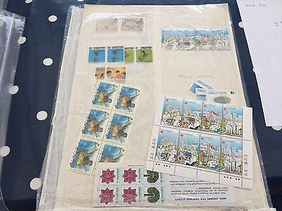 Singapore assortment of nhm stamps on stock page nice lot