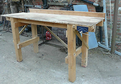 Wooden work bench with vice