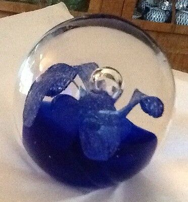 Glass Paperweight With A Blue Flower