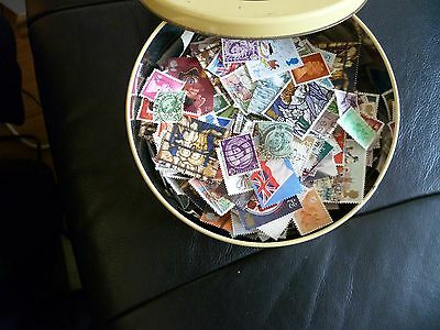 Job lot  of 1100-1200  Used UK Stamps Off Paper various ages