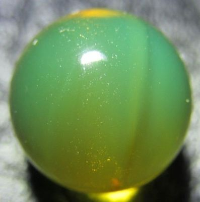 Ref.# 759- Dominican Green Amber natural round sphere bead 10.7 mm( 0.7 g)