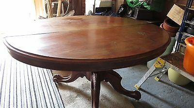 Antique oval victorian tilt top table