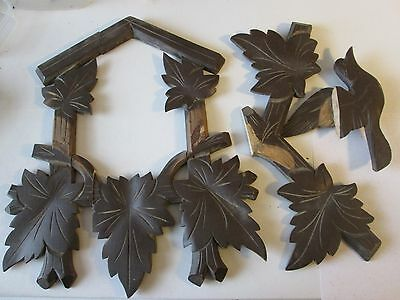 4 Old and Worn Cuckoo Clock Framing Leaf and Bird Design