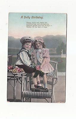 CHARMING POSTCARD OF A GIRL AND BOY OUTDOOR SCENE (A JOLLY BIRTHDAY) No 3047.