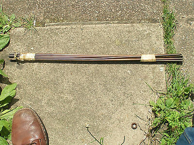 Ten brass cased stair rods