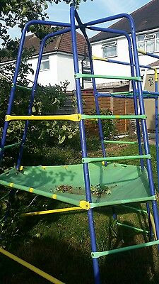 Tp climbing frame and monkey bars with den cover