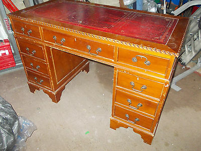 Captains Table Desk With Multidrawers Endulging Red Leather Table Top