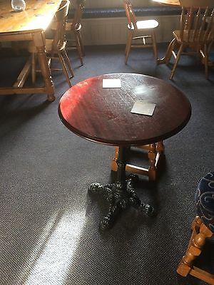 Round pub table in dark wood and metal base. 2 available