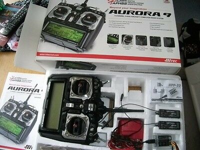 Hitec aurora 9 transmitter and optima 7 receivers, programmer and charger. boxed