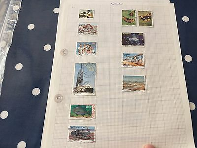 Namibia nice assortment of stamps on album pages direct from estate untouched