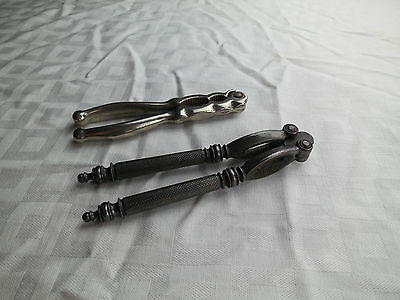 A pair of antique metal nut crackers 101