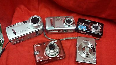 Polaroid , Sanyo , Olympus , Canon, Sony Digital Camera Lot sold as is