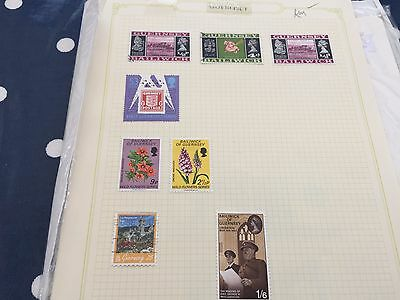 Channel Islands GB UK assortment of stamps on pages Alderney Guernsey etc
