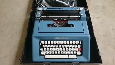 Vintage retro typewriter Olivetti blue Studio 46 portable & black carry case