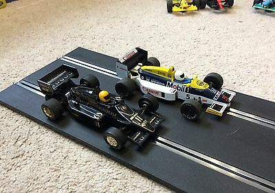 Two Scalextric F1 cars - Senna Lotus and Mansell Williams