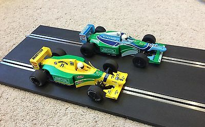 Two Scalextric Benetton F1 cars