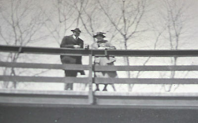 Old POSTCARD Man and Woman standing on Bridge Photo Unposted