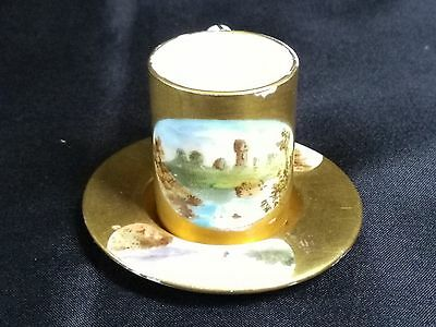 Rare Antique Coalport Gilded Miniature Cup and Saucer with handpainted panels