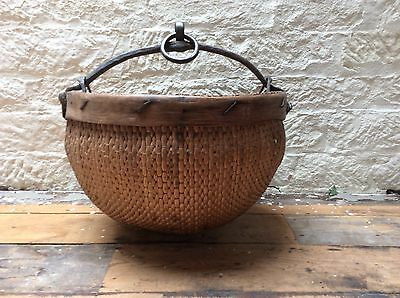 Antique Chinese rice basket. Made from woven Willow with a Cast Iron handle