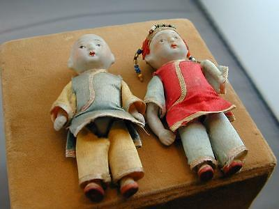 Vintage Pair of Japanese Porcelain Dolls w/Silk or Satin Clothing
