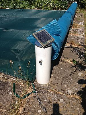 Solar powered reel system for swimming pool cover