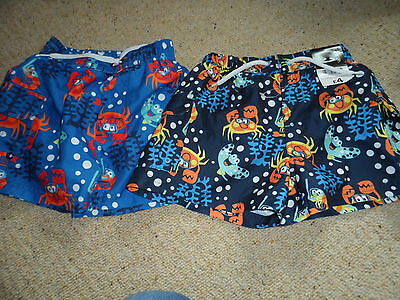 Bnwt new 2 pairs of boys swimming shorts with sea life detailage 18-24 months