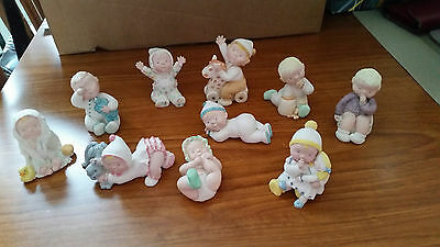 10 collectable miniature baby/toddler ornaments