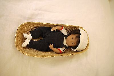 1980's Sasha Baby Doll in Basket with corduroy jumpsuit and white cap