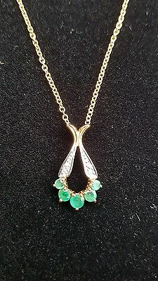 9ct gold Emerald and diamond pendant with chain.