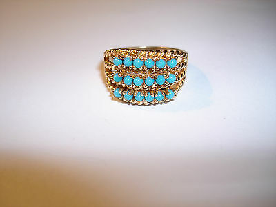 A TURQUOISE SET DRESS RING IN 14ct GOLD