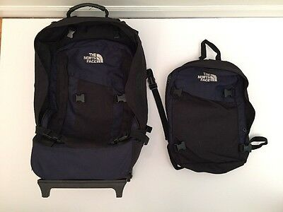 The North Face Rolling Black Duffle Bag Travel Luggage Backpack