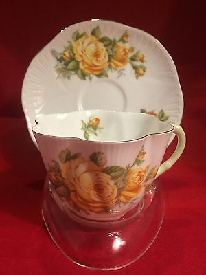 Shelley Dainty Yellow Roses Green Handle Gold Trim Cup and Saucer