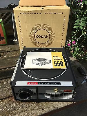 Vintage KODAK carousel projector model 550. Works Great. Includes Free Shipping